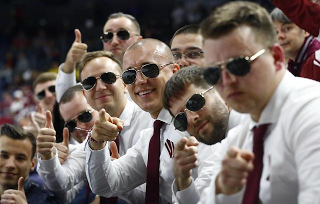<p>Latvia fans pose for a photo during a Latvia vs. Slovakia game at the Ice Hockey World Championships in Cologne, Germany, May 7, 2017. (Wolfgang Rattay/Reuters) </p>
