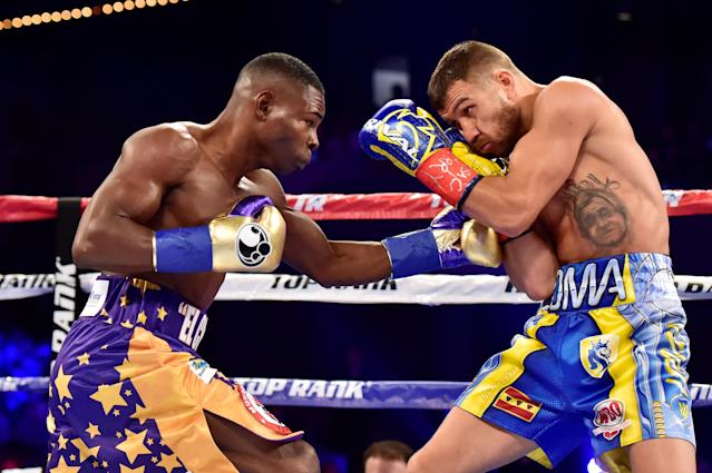 Guillermo Rigondeaux punches Vasiliy Lomachenko (R) during their Junior Lightweight bout at Madison Square Garden on December 9, 2017 in New York City. (Getty Images)