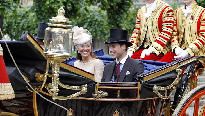 Catherine, Duchess of Cambridge and Prince William, Duke of Cambridge leave Westminster Hall after a Diamond Jubilee Luncheon given for The Queen by The Livery Companies of The City of London on June 5, 2012 in London, England. For only the second time in its history the UK celebrates the Diamond Jubilee of a monarch. Her Majesty Queen Elizabeth II celebrates the 60th anniversary of her ascension to the throne today with a carriage procession and a service of thanksgiving at St Paul's Cathedral. (Photo by Peter Byrne - WPA Pool/Getty Images)