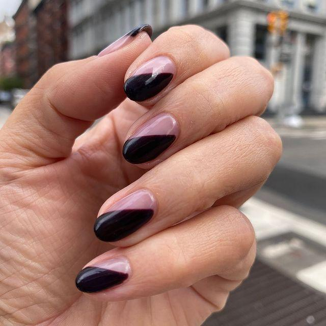 """<p>The secret to this look? Use nail tape to get clean lines for the half of your nail that you use polish.</p><p><a href=""""https://www.instagram.com/p/CGammcjJm5W/&hidecaption=true"""" rel=""""nofollow noopener"""" target=""""_blank"""" data-ylk=""""slk:See the original post on Instagram"""" class=""""link rapid-noclick-resp"""">See the original post on Instagram</a></p>"""