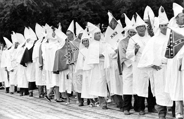 <p>About 75 Klansmen and women in robes protest the civil rights bill as they parade through the streets of St. Augustine, Fla., July 4, 1964. (Photo: Bill Hudson/AP) </p>