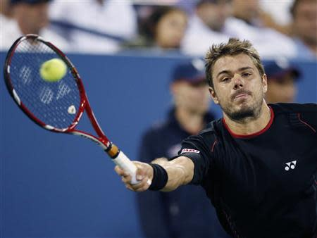 Stanislas Wawrinka of Switzerland reaches for a forehand to Tomas Berdych of the Czech Republic at the U.S. Open tennis championships in New York