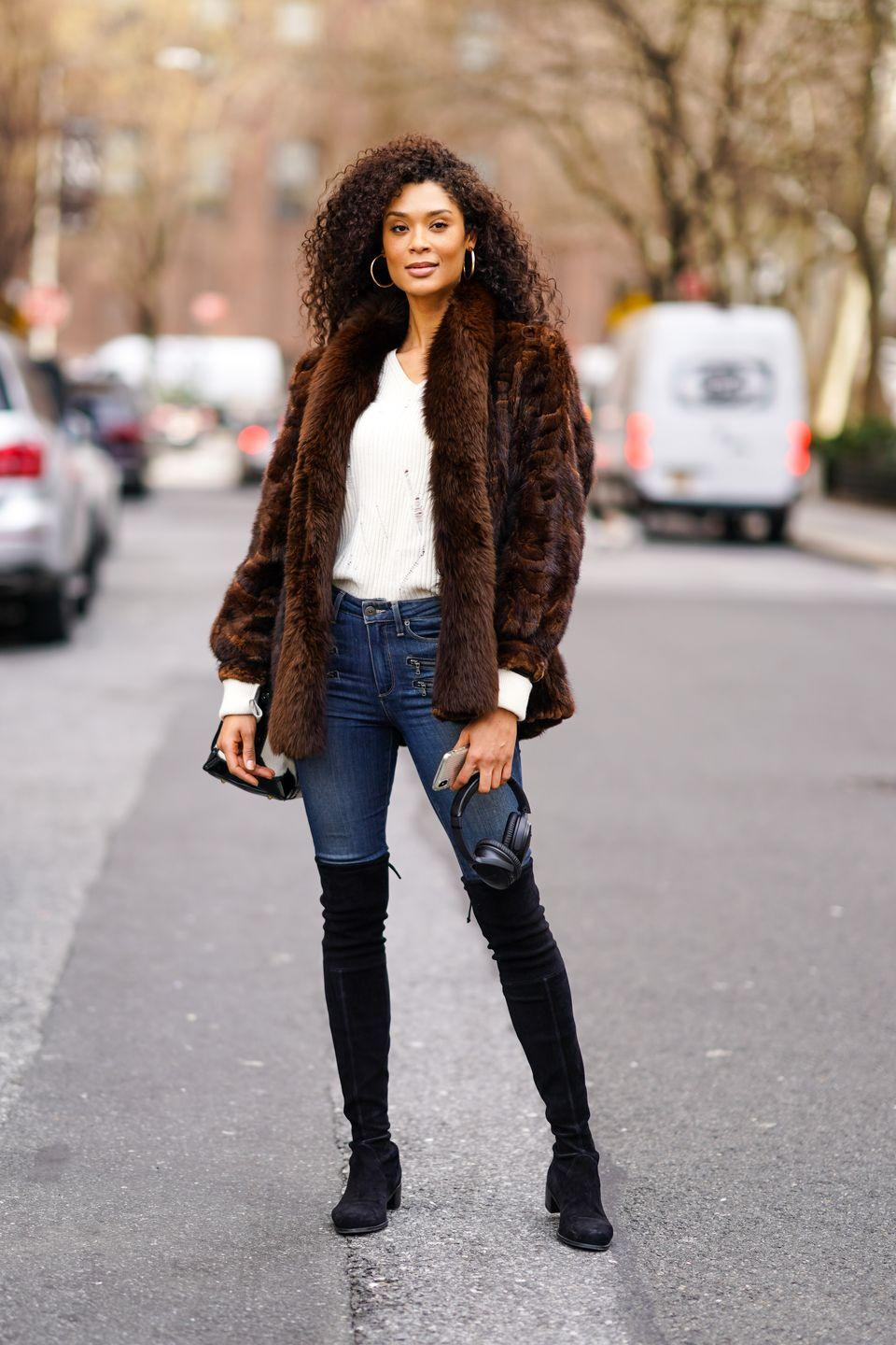 <p>Don't overthink it! Sometimes a good ol' pair of jeans and a faux-fur jacket over a sweater is just the thing; plus, it's dressy and low-key at the same time. </p>