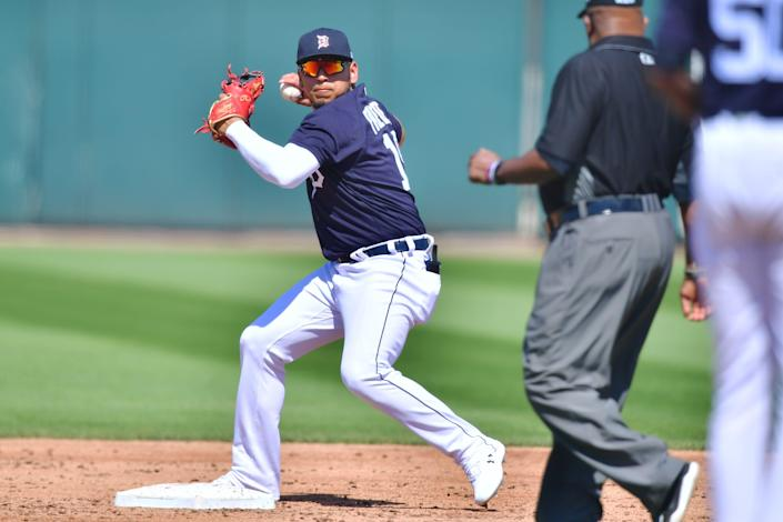Isaac Paredes of the Detroit Tigers turns a double play in the third inning against the New York Yankees during a spring training game on March 12, 2021, at Joker Marchant Stadium in Lakeland, Florida.