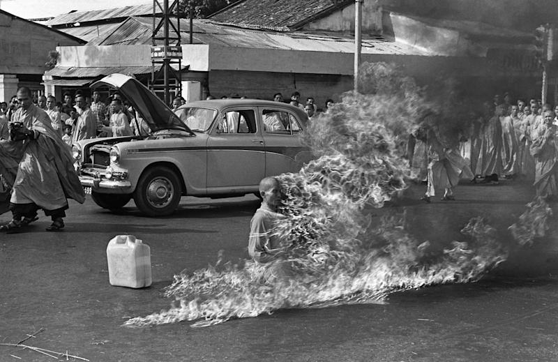 FILE - This is a  June 11, 1963 file photo of Thich Quang Duc, a Buddhist monk, burns himself to death on a Saigon street South Vietnam  to protest alleged persecution of Buddhists by the South Vietnamese government. (AP Photo/Malcolm Browne, File)