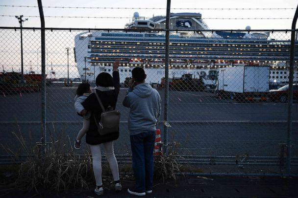PHOTO: Relatives of passengers wave towards the Diamond Princess cruise ship, with around 3,600 people quarantined on board due to fears of the new coronavirus, at the Daikoku Pier Cruise Terminal in Yokohama, Japan, on Feb. 11, 2020. (Charly Triballeau/AFP via Getty Images)