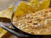 <p>Who doesn't love some good queso? But with all that saturated fat and excessive calories, it's not looking so great in the nutrition department.</p>