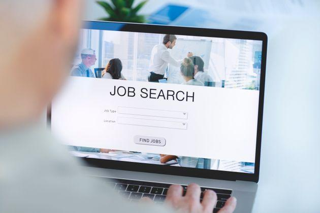 Mature Businessman looking at job search website on a laptop computer. Job type, location and Find jobs buttons (Photo: courtneyk via Getty Images)