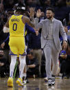 Golden State Warriors' Stephen Curry, right, congratulates D'Angelo Russell (0) during a timeout in the second half of the team's NBA basketball game against the Orlando Magic on Saturday, Jan. 18, 2020, in San Francisco. (AP Photo/Ben Margot)