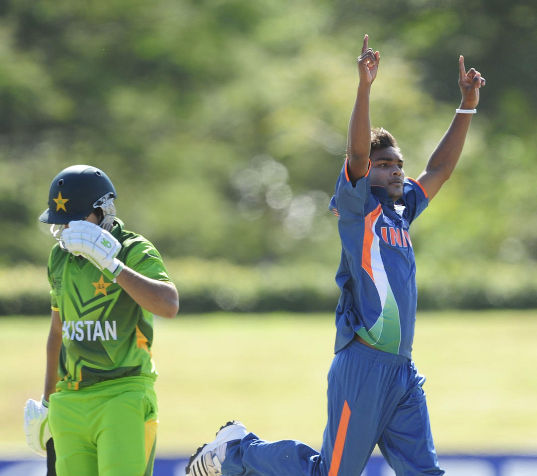 TOWNSVILLE, AUSTRALIA - AUGUST 20:  Sandeep Sharma of India celebrates the wicket Inman-ul-Haq of Pakistan during the ICC U19 Cricket World Cup 2012 Quarter Final match between India and Pakistan at Tony Ireland Stadium on August 20, 2012 in Townsville, Australia.  (Photo by Ian Hitchcock-ICC/Getty Images)