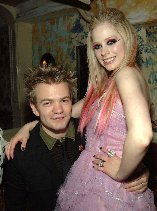 Avril Lavigne's love of colored hair extensions outlasted her love for her first husband, Deryck Whibley, pictured with her in 2007. (Photo: Theo Wargo/WireImage)