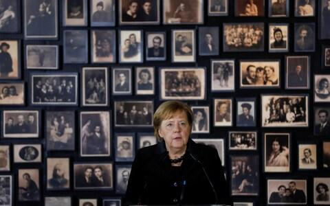 "German Chancellor Angela Merkel speaks in the building of the so-called ""Sauna"" during her visit visit at the former Nazi German concentration and extermination camp Auschwitz-Birkenau near Oswiecim, Poland, December 6, 2019. REUTERS/Kacper Pempel - Credit: KACPER PEMPEL/REUTERS"