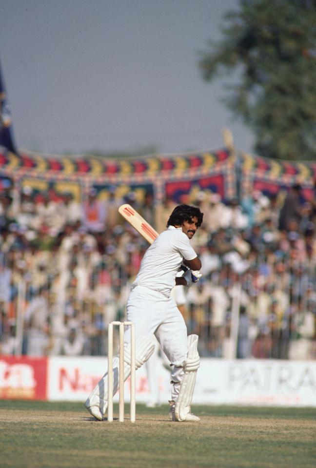 The Second Test Match at Faisalabad, during the West Indies tour of Pakistan, December 1980. Javed Miandad, Captain of Pakistan hits off for Marshall. (Photo by Adrian Murrell/Getty Images)