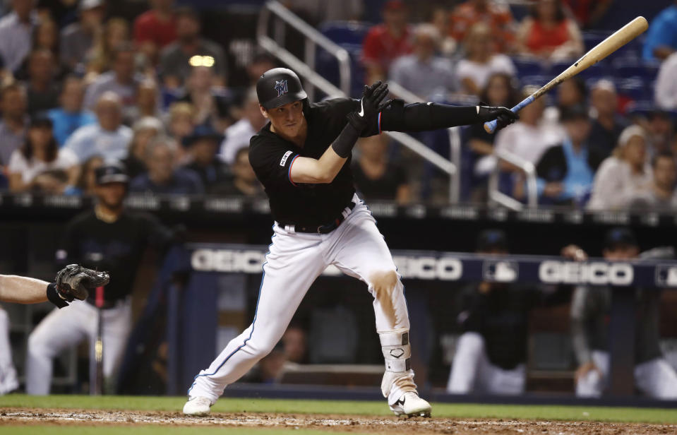 Miami Marlins' Brian Anderson hits a single during the eight inning of a baseball game against the Atlanta Braves, Saturday, Aug. 10, 2019, in Miami. (AP Photo/Brynn Anderson)