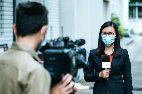 """<span class=""""caption"""">Need to know: people have been more willing to pay for high-quality information during the COVID-19 pandemic.</span> <span class=""""attribution""""><a class=""""link rapid-noclick-resp"""" href=""""https://www.shutterstock.com/image-photo/reporter-woman-holding-microphone-reporting-news-1779653228"""" rel=""""nofollow noopener"""" target=""""_blank"""" data-ylk=""""slk:2p2play/Shutterstock"""">2p2play/Shutterstock</a></span>"""