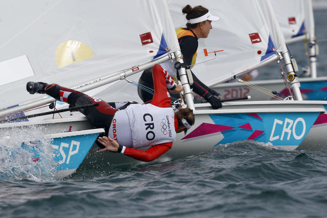 Croatia's Tina Mihelic falls outboard during the laser radial class race at the London 2012 Summer Olympics, Friday, Aug. 3, 2012, in Weymouth and Portland, England. (AP Photo/Francois Mori)