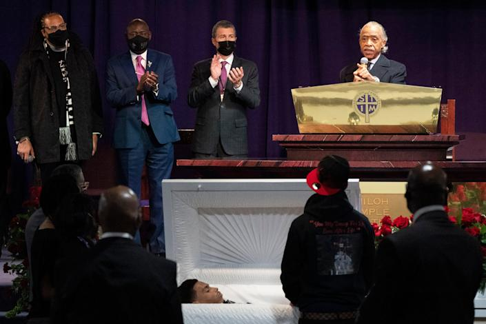 <p>The Rev. Al Sharpton, right, speaks over the casket of Daunte Wright, alongside attorneys Antonio Romanucci, center, and Ben Crump, center left, and the Rev. Greg Drumwright, left, Wednesday, April 21, 2021, in Minneapolis. The 20-year-old Wright was killed by former Brooklyn Center police Officer Kim Potter during a traffic stop. </p> ((AP Photo/Julio Cortez))