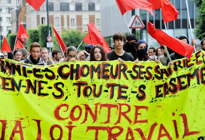 People protest in Rennes, western France, on June 23, 2016 against the government's planned labour law reforms (AFP Photo/Jean-Francois Monier)