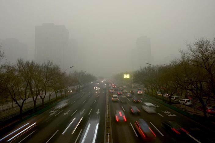 Beijing is introducing traffic curbing measures as smog levels approach dangerous levels (AFP Photo/Wang Zhao)