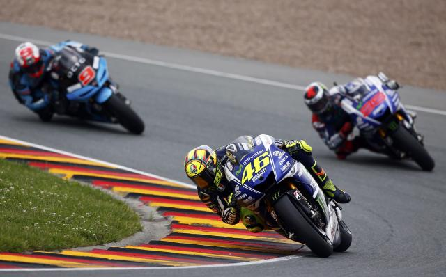 Yamaha Moto GP rider Valentino Rossi of Italy (C) competes during the German Grand Prix at the Sachsenring circuit in the eastern German town of Hohenstein-Ernstthal July 13, 2014. REUTERS/Thomas Peter (GERMANY - Tags: SPORT MOTORSPORT)
