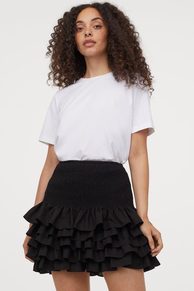 "<p>This <a href=""https://www.popsugar.com/buy/HampM-Ruffled-Cotton-Skirt-580546?p_name=H%26amp%3BM%20Ruffled%20Cotton%20Skirt&retailer=www2.hm.com&pid=580546&price=50&evar1=fab%3Aus&evar9=47523854&evar98=https%3A%2F%2Fwww.popsugar.com%2Ffashion%2Fphoto-gallery%2F47523854%2Fimage%2F47538040%2FHM-Ruffled-Cotton-Skirt&list1=shopping%2Ch%26m%2Csummer%20fashion%2Cfashion%20shopping&prop13=mobile&pdata=1"" class=""link rapid-noclick-resp"" rel=""nofollow noopener"" target=""_blank"" data-ylk=""slk:H&amp;M Ruffled Cotton Skirt"">H&amp;M Ruffled Cotton Skirt </a> ($50) looks chic with strappy heels.</p>"