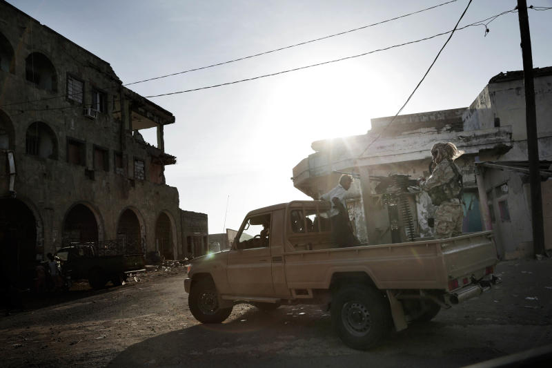 FILE - In this Feb. 12, 2018, file photo, Saudi-led coalition backed forces petrol, Mocha, Yemen. Moroccan government officials said Thursday Feb. 7, 2019 that Morocco has stopped taking part in military action with the Saudi-led coalition in Yemen's war, and has recalled its ambassador to Saudi Arabia. (AP Photo/Nariman El-Mofty, File)