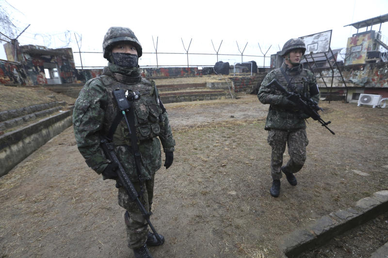 FILE - In this Monday, Dec. 3, 2018, file photo, South Korean army soldiers stand guard at a guard post inside the Demilitarized Zone (DMZ) in the central section of the inter-Korean border in Cheorwon, South Korea. South Korea said Thursday, Dec. 6, 2018, the two Koreas will jointly verify each other's works to remove some of their front-line guard posts next week. In the past weeks, the Koreas each dismantled or disarmed 11 of their guard posts as part of agreements to reduce tensions that were reached during their leaders' summit in Pyongyang in September. (AP Photo/Ahn Young-joon. File)