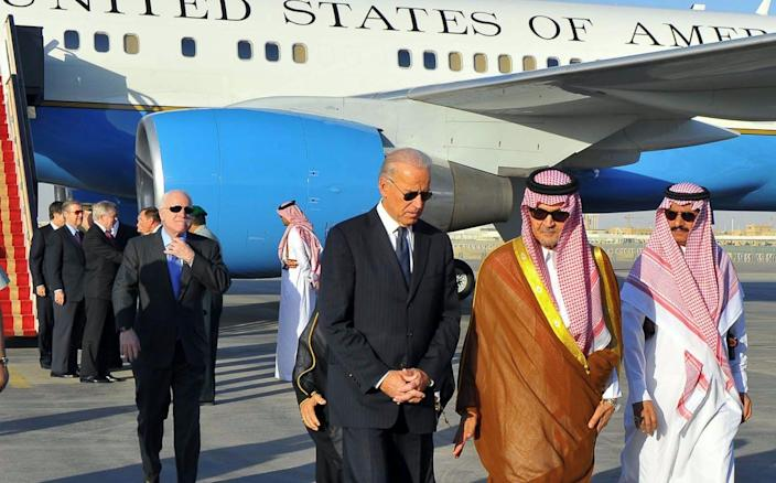 """<span class=""""caption"""">Vice President Biden with a U.S. delegation at the Riyadh airport in Saudi Arabia in 2011. </span> <span class=""""attribution""""><a class=""""link rapid-noclick-resp"""" href=""""https://www.gettyimages.com/detail/news-photo/saudi-foreign-minister-prince-saud-al-faisal-welcomes-us-news-photo/130620634?adppopup=true"""" rel=""""nofollow noopener"""" target=""""_blank"""" data-ylk=""""slk:STR/AFP via Getty Images"""">STR/AFP via Getty Images</a></span>"""