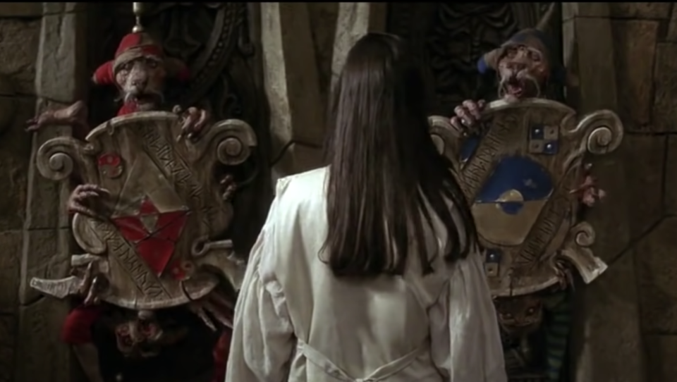 Sarah is challenged by the Four Guards in a scene from Labyrinth (Photo: TriStar/YouTube)