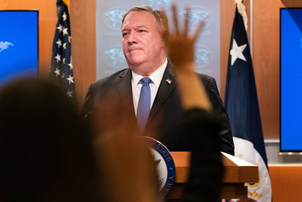 """US Secretary of State Mike Pompeo speaks during a briefing, on November 10, 2020, at the State Department in Washington,DC. - Secretary of State Mike Pompeo on Tuesday promised the world a """"smooth transition"""" after US elections but refused to recognize President-elect Joe Biden's victory, saying Donald Trump will remain in power. """"There will be a smooth transition to a second Trump administration,"""" Pompeo said in an at times testy news conference when asked about contacts with the Biden team. (Photo by Jacquelyn Martin / POOL / AFP) (Photo by JACQUELYN MARTIN/POOL/AFP via Getty Images)"""