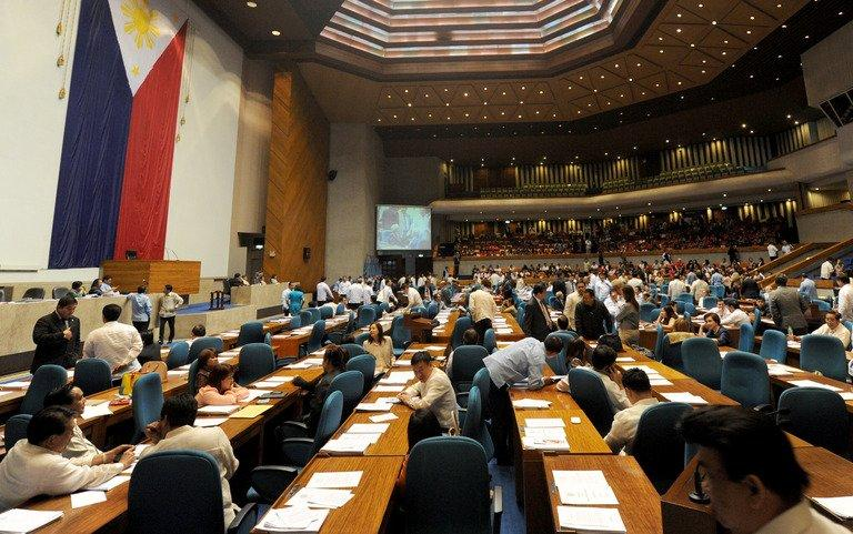 Members of the Philippine house of representatives meet to vote in Quezon City, on August 6, 2012