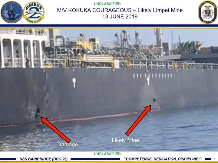 A picture released by U.S. Central Command shows damage from an explosion (L) and a likely limpet mine, on the hull of the civilian vessel M/V Kokuka Courageous in the Gulf of Oman in the Arabian Sea, in waters between Gulf Arab states and Iran, June 13, 2019. Picture taken June 13, 2019. U.S. Navy/Handout via REUTERS ATTENTION EDITORS- THIS IMAGE HAS BEEN SUPPLIED BY A THIRD PARTY.
