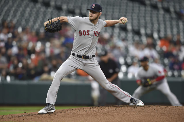 Boston Red Sox pitcher Chris Sale throws to a Baltimore Orioles batter during the first inning of a baseball game Wednesday, May 8, 2019, in Baltimore. (AP Photo/Gail Burton)