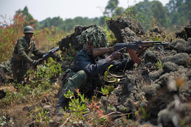 Congolese soldiers pictured to the north-west of Munigi, overlooking the front-line in the east of the Democratic Republic of the Congo, on July 15, 2013