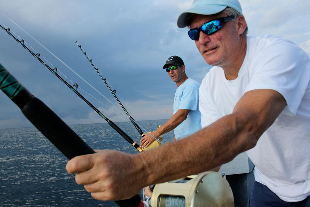 Gloucester, MA - Captain Ralph Wilkins and First Mate Jason Cardinale demonstrate their reel power.