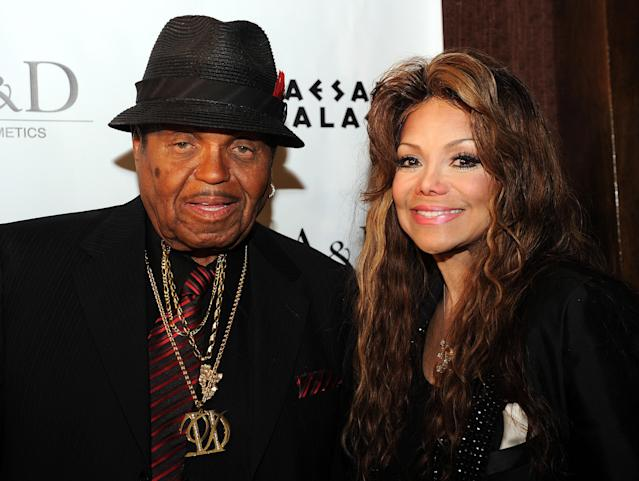 Joe Jackson and his daughter La Toya Jackson pose in Las Vegas on June 9, 2011. She is one of the family members sharing an online tribute to the controversial talent manager. (Photo: Gabriel Bouys/AFP/Getty Images)