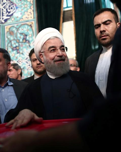 Iranian President Hassan Rouhani, who won a resounding re-election victory, casts his vote in Tehran on May 19, 2017