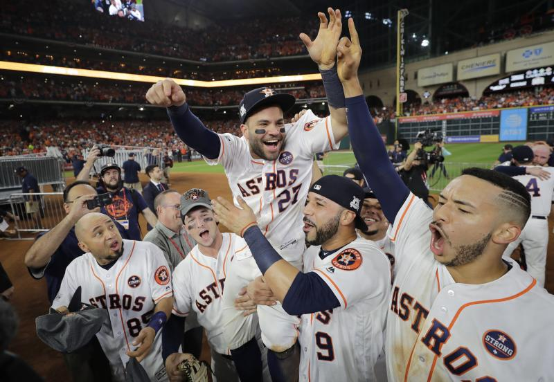 28f581139 Houston Astros  Jose Altuve is lifted by teammates after Game 7 of  baseball s American League Championship Series against the New York Yankees  Saturday