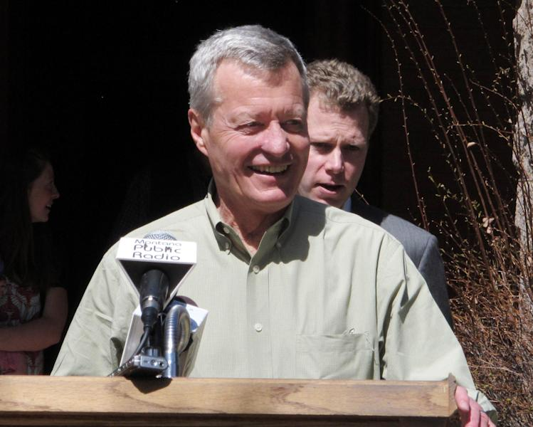 U.S. Sen. Max Baucus greets supporters outside his family home in Helena, Mont., on Friday, April, 26, 2013. Baucus spoke to reporters about his decision not to run for another term in 2014 and about his legislative priorities, including reforming the federal tax code. (AP Photo/Matt Volz)