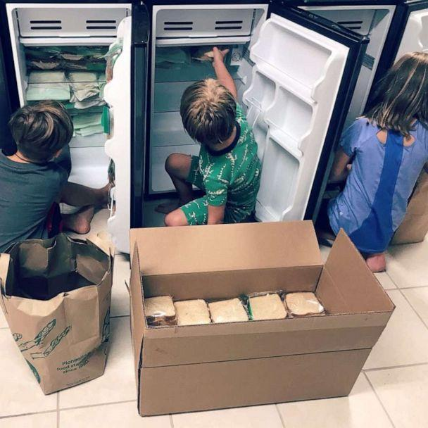 PHOTO: Sterling and Amber Marchand's children stock mini-refrigerators with food that has been donated. (Amber and Sterling Marchand/Be The Good Project)