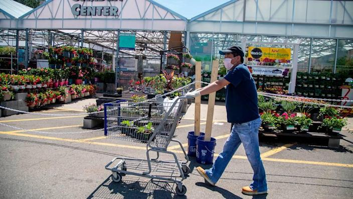 Lowe's Home Improvement will require all workers to wear a face mask or approved face covering while working in a store or at a customer's home because of the new coronavirus crisis, the NC-based company said.