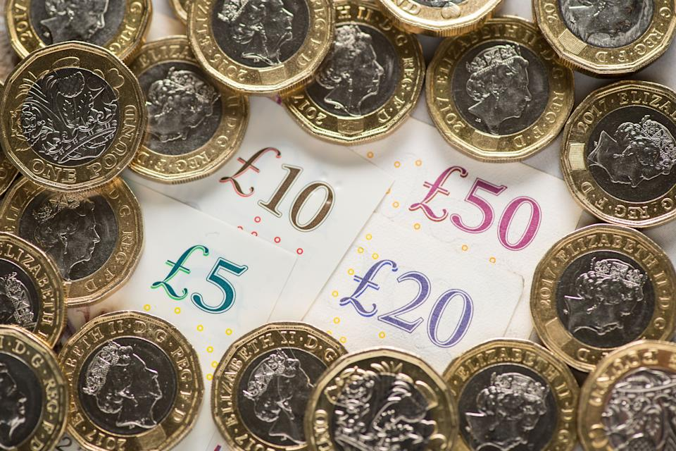 File photo dated 26/01/18 of UK five pound, ten pound, twenty pound and fifty pound notes with one pound coins. Three in four people think Covid-19 will continue to affect their use of cash going into 2021, a survey has found.