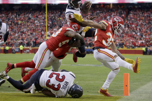 Houston Texans quarterback Deshaun Watson (4) scores a touchdown against Kansas City Chiefs linebacker Anthony Hitchens (53) and safety Tyrann Mathieu (32) during the second half of an NFL divisional playoff football game, in Kansas City, Mo., Sunday, Jan. 12, 2020. (AP Photo/Charlie Riedel)