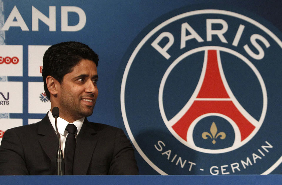 FILE - In this Wednesday, Jan. 29, 2014 file photo PSG President Nasser Al-Khelaifi smiles during a press conference, at the Parc des Princes stadium in Paris. In a verdict handed down Friday Oct. 30, 2020, Swiss federal judges acquitted the Qatari president of Paris Saint-Germain Nasser Al-Khelaifi. (AP Photo/Thibault Camus, File)
