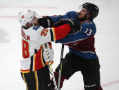 Calgary Flames center Elias Lindholm, left, fights with Colorado Avalanche center Alexander Kerfoot during the first period of Game 4 of an NHL hockey playoff series Wednesday, April 17, 2019, in Denver. (AP Photo/David Zalubowski)