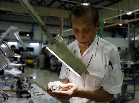 Mohamad Mohsin Khan, 74, assembles aircraft parts at ACE Services in Singapore December 17, 2018. REUTERS/Edgar Su/Files