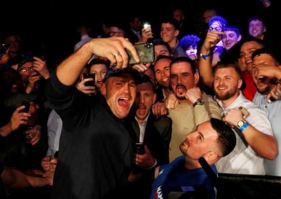 Fury enjoyed himself as he watched younger brother Tommy win again (Action Images)