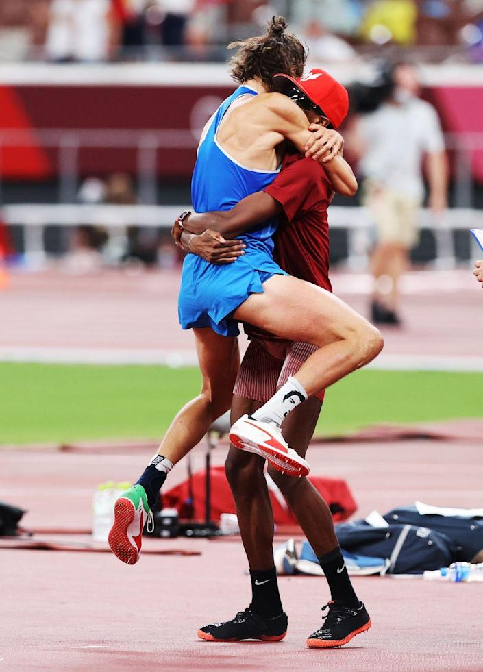 <p>Italy's Gianmarco Tamberi and Qatar's Muta Essa Barshim celebrate with a heartwarming hug after deciding to share the gold medal in the High Jump.</p>