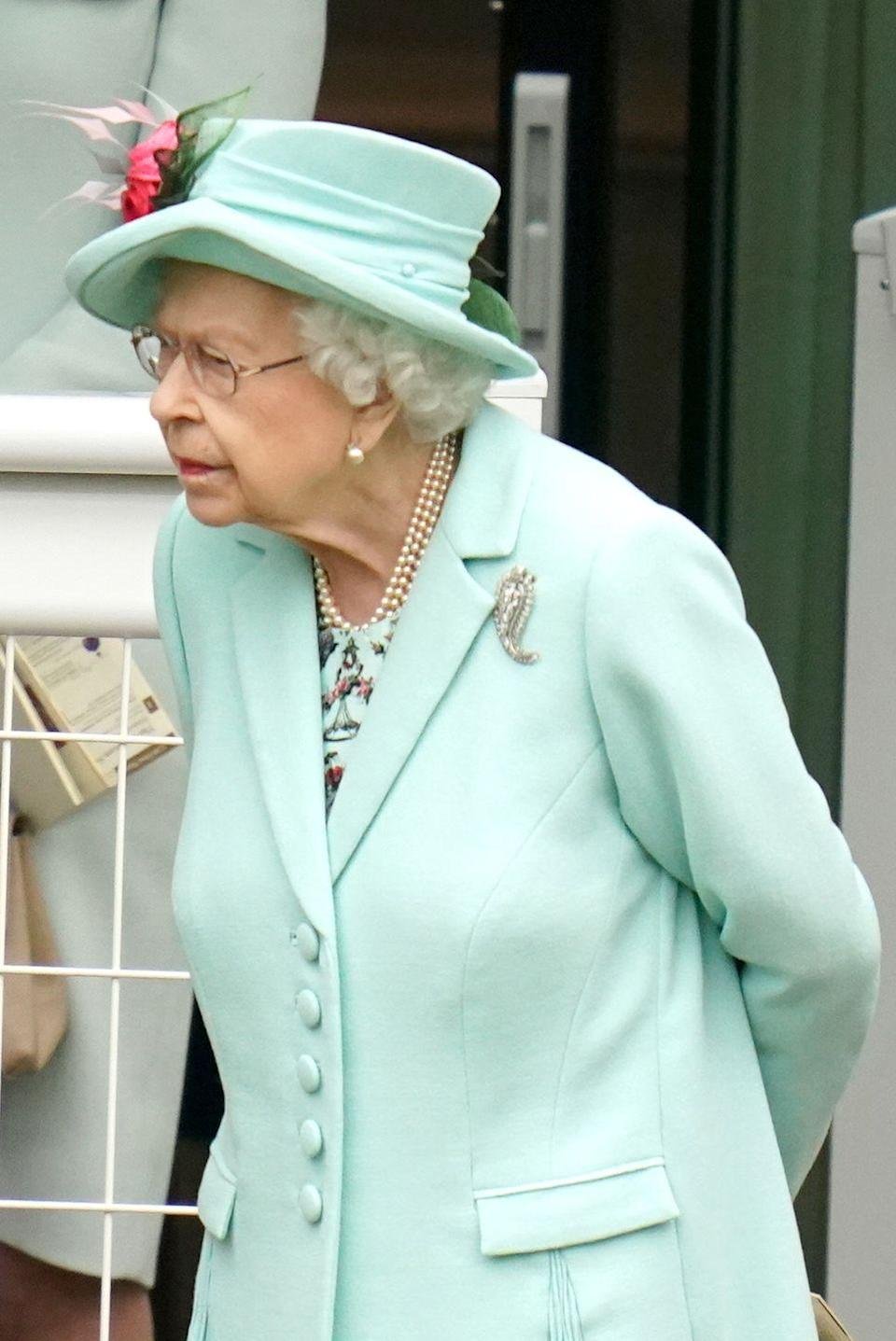 <p>For today's events, the Queen opted for a pale blue ensemble with a matching hat adorned with striking pink flowers.</p>