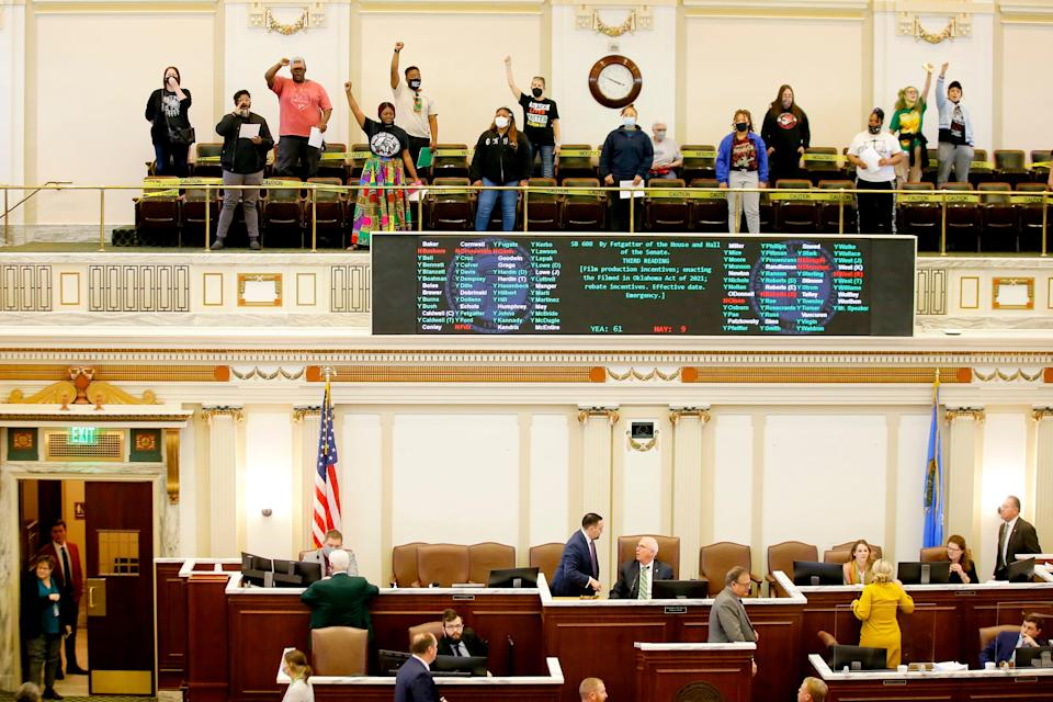 Demonstrators disrupt the House Wednesday at the state Capitol as they protest recent bills passed by the Legislature.